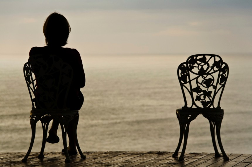 Lonely girl on a chair